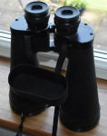 Fujinon 16 x 70, on a tripod these are great for astronomy and other long distance observing. Closest focus 100 feet.